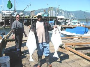 Another happy D&D Fishing Charters customer with his bounty of halibut